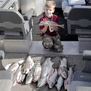 A big pile of Fall Chinook Salmon caught in part by this young fisherman.