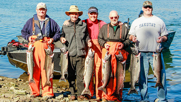columbia river fishermen pose with their catch of salmon