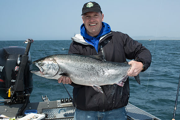 A nice salmon being held up at the mouth of winchester bay