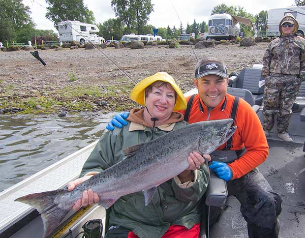 Sweet lady with a super sweet chinook salmon from the Willamette River.