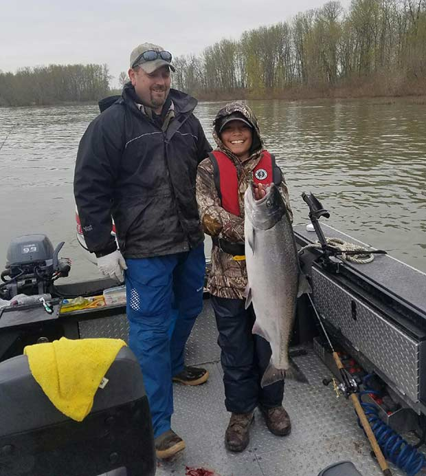Really nice Columbia River Spring Chinook held by a young fisherman.