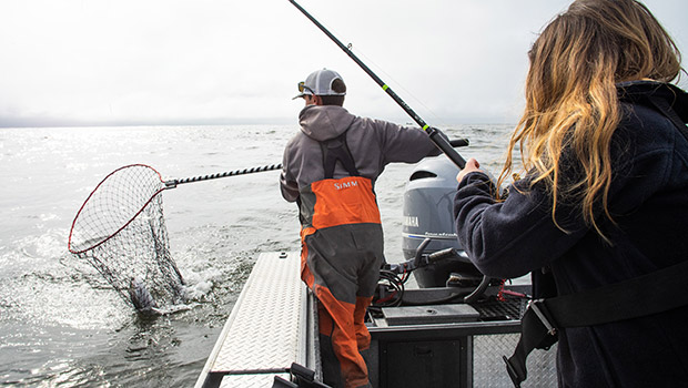 Nick netting a beautiful astoria ocean salmon