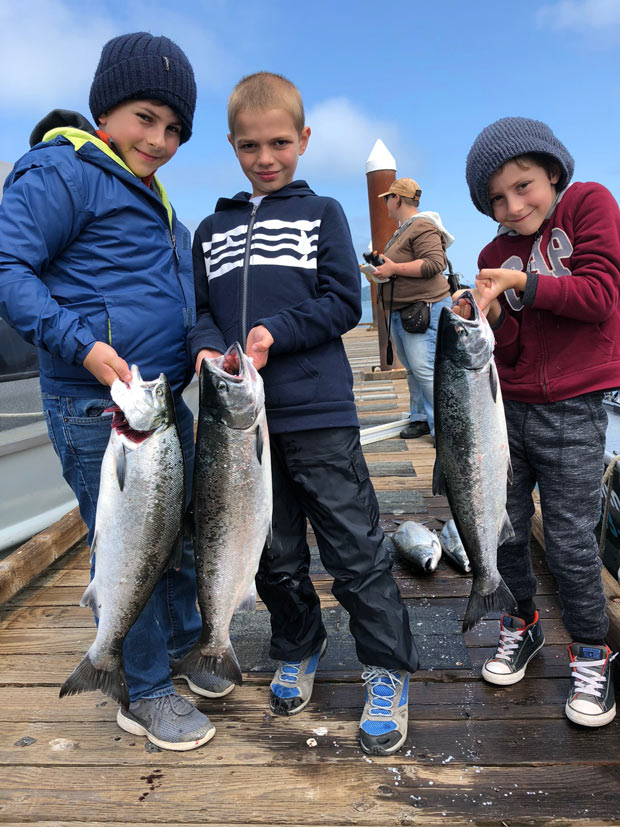 three kids with their catch at buoy 10