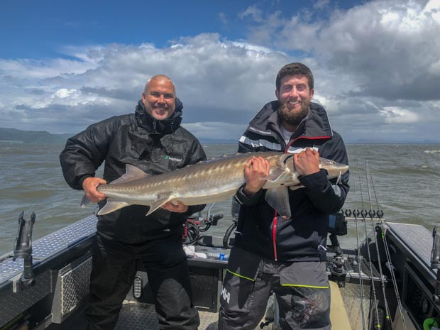 2 men with a keeper sturgeon