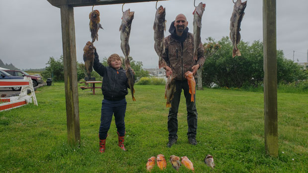 Father and son with their bottom fish catch!