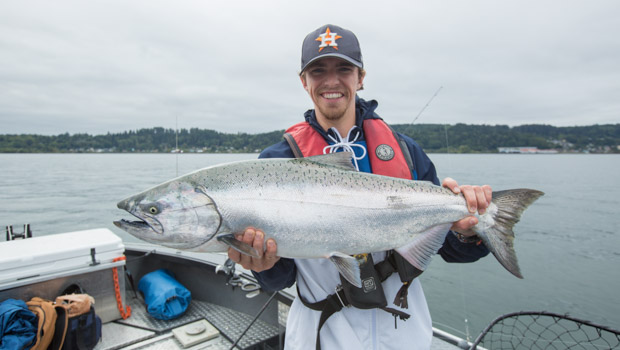 Happy young man with his Astoria Coho Salmon