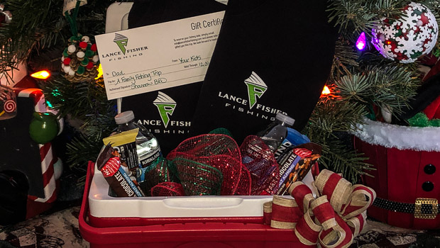 Gift certificate and T-shirts in a cooler under the Christmas tree