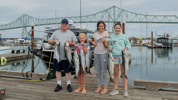 Grandpa and granddaughters with Buoy 10 Salmon